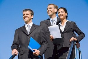 8395757-team-of-business-people-on-the-background-of-blue-sky